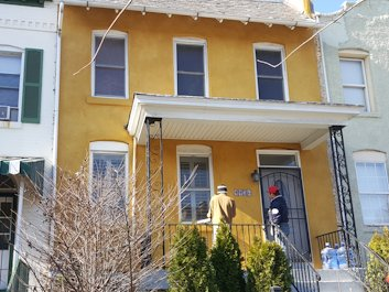 Bright Sante FE stucco colors brighten up this townhouse in Northeast Washington, DC
