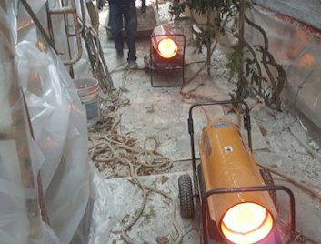 Heaters and plastic tents allow work to proceed in cold weather